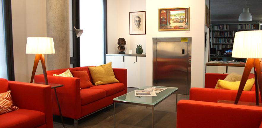 The sitting room area of the library, with comfortable seating and artworks.
